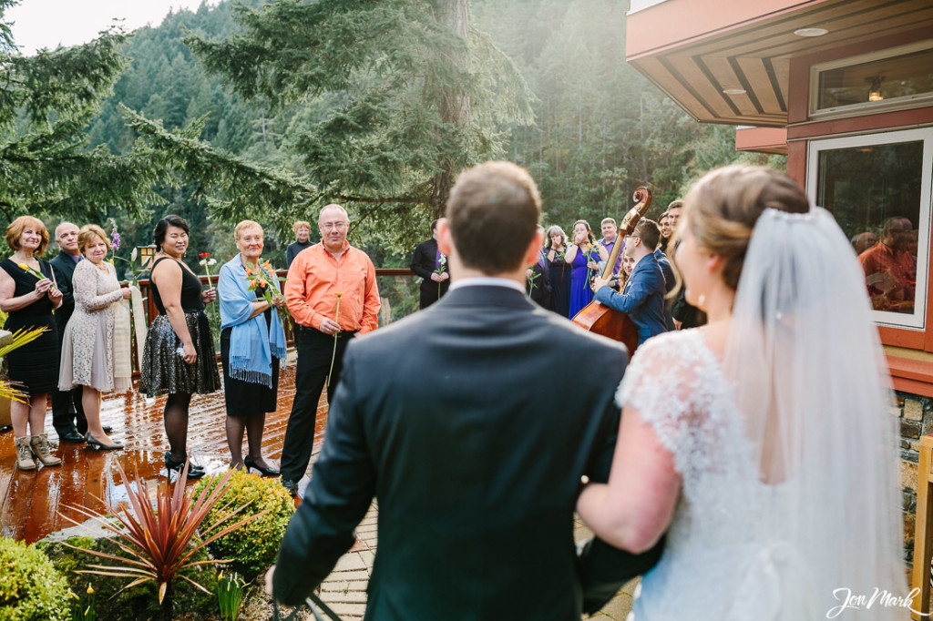 Microwedding ceremony. Guests witing, couple enters together