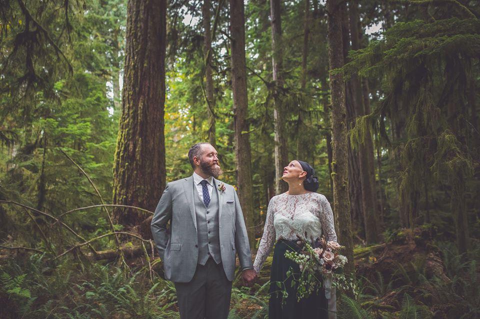 in Cathrdral Grover, a bruide appreciated the tall trees and a groom appreciates the bride