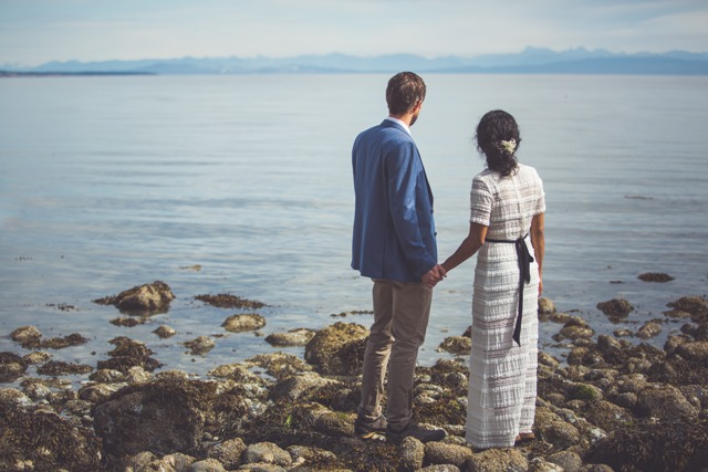 Elopement Vancouver Island couple stading at the water's edge